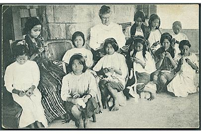 In the Philippines. Teaching Lace - Making, Protestant Episcopal Mission, Bontoc.