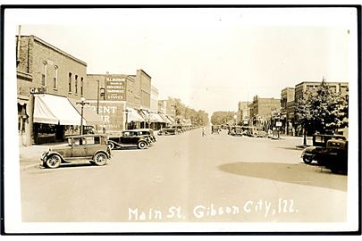 USA, Gibson City, Ill., Main Street med automobiler. U/no.